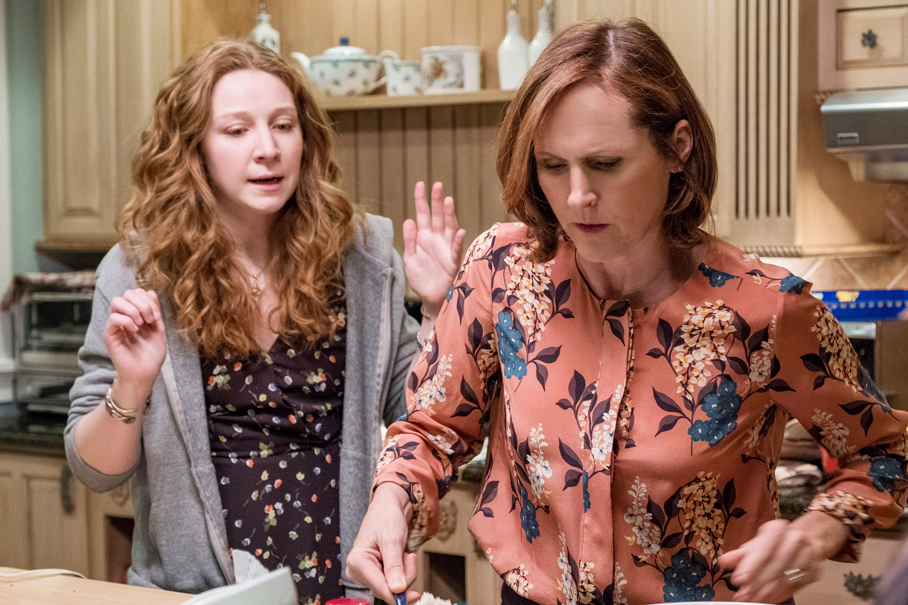 Kayli Carter talks to Molly Shannon while she's cooking