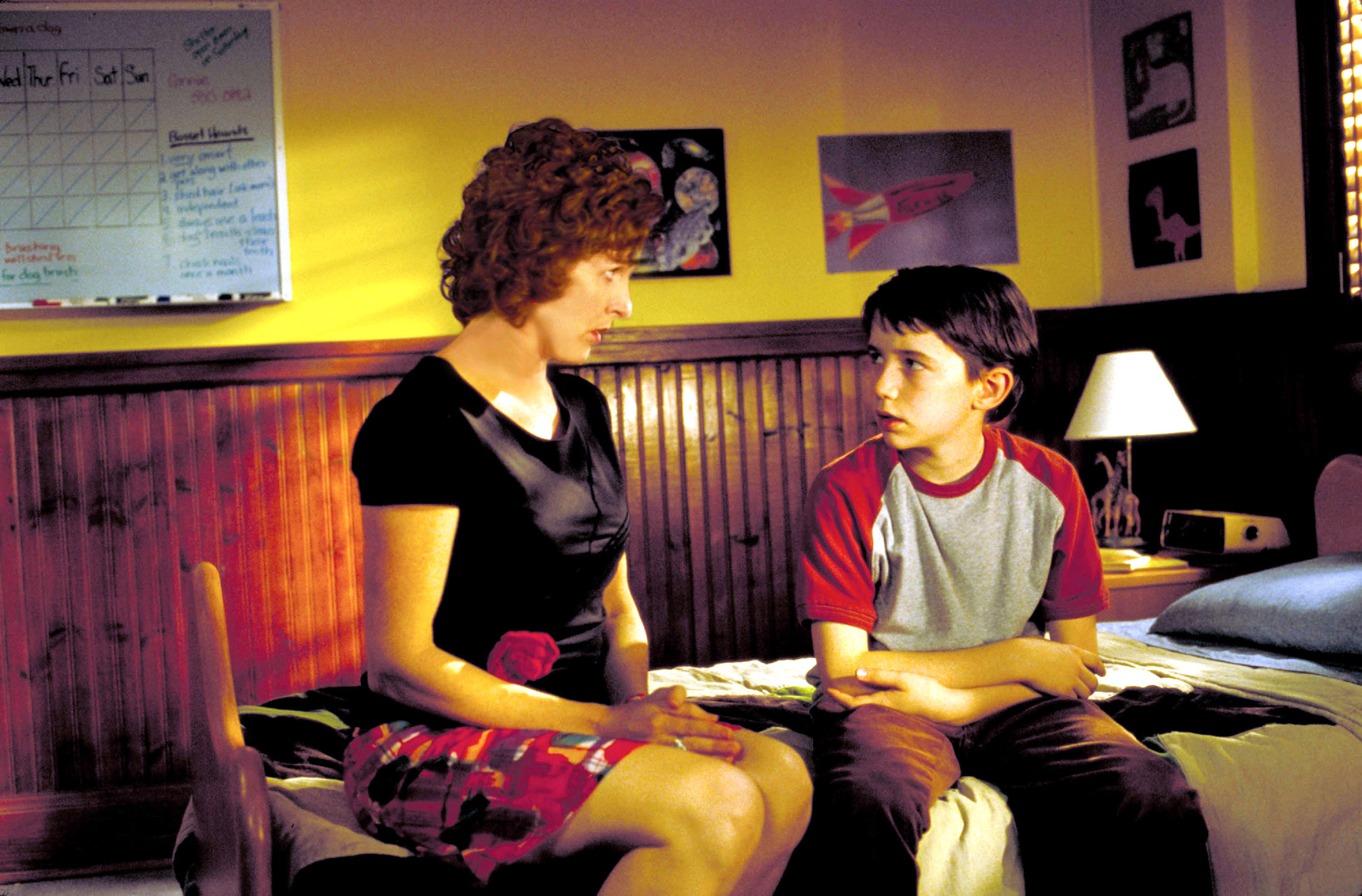 Molly Shannon sits on a bed as she talks with Liam Aiken