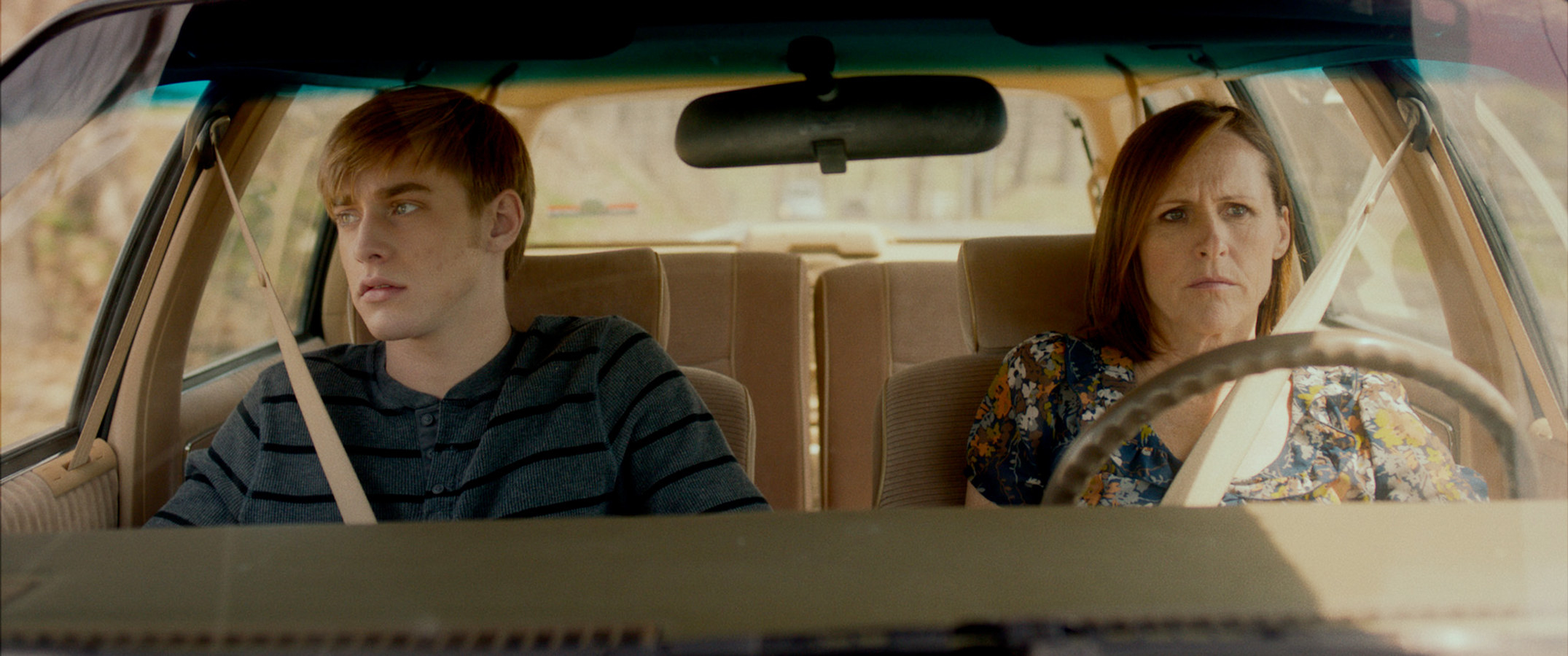 Molly Shannon sits in a car with Tim Boardman