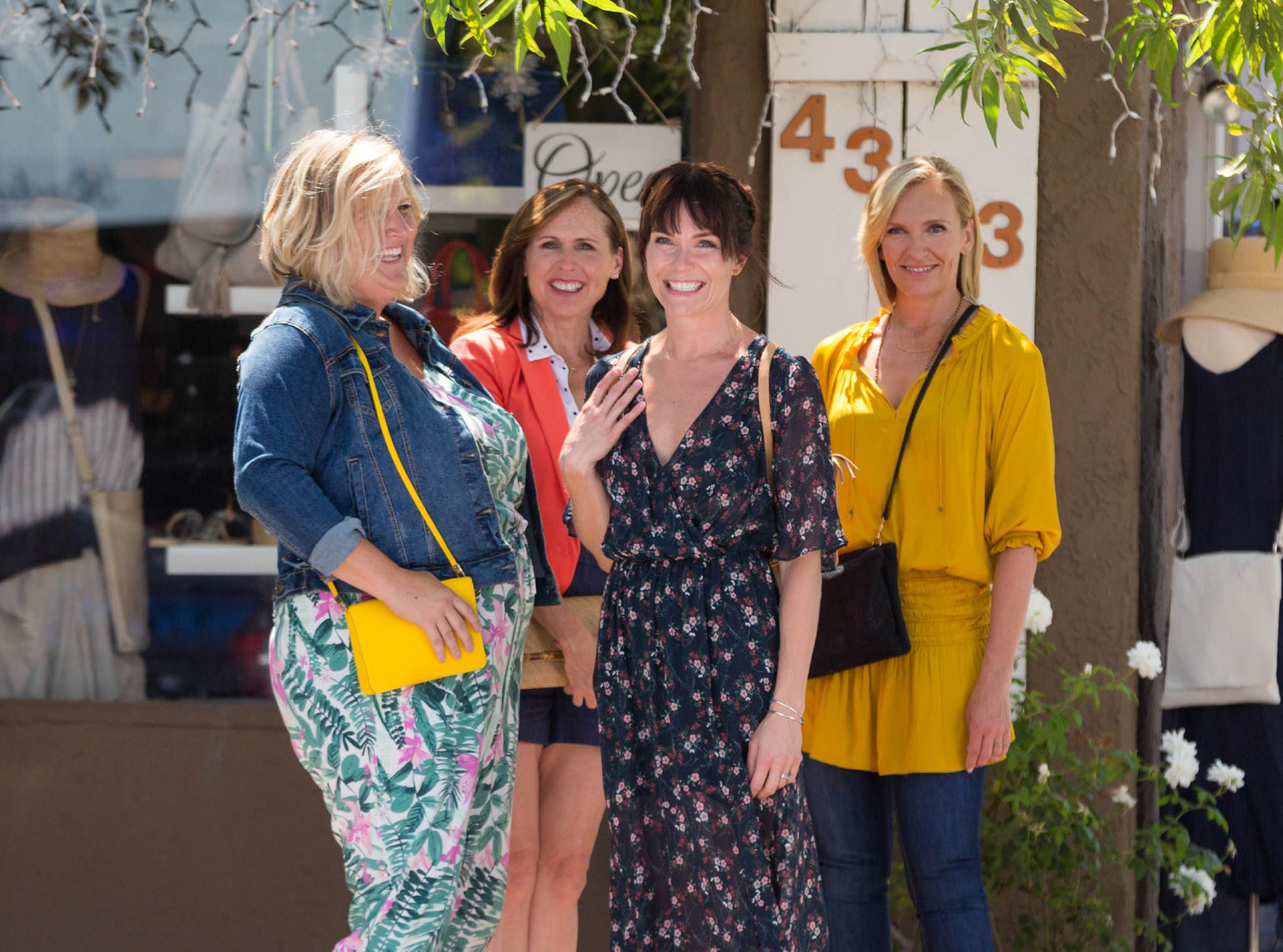 Bridget Everett, Molly Shannon, Katie Aselton, and Toni Collette stand outside a restaurant