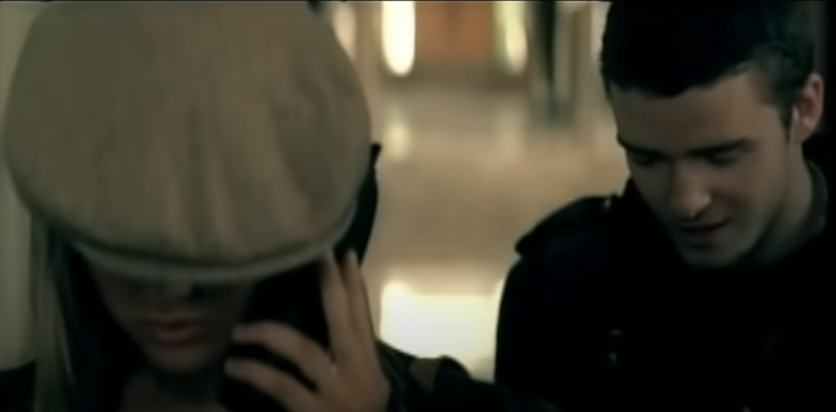 """A frame from the """"Cry Me a River"""" music video showing Justin Timberlake and a female actor"""
