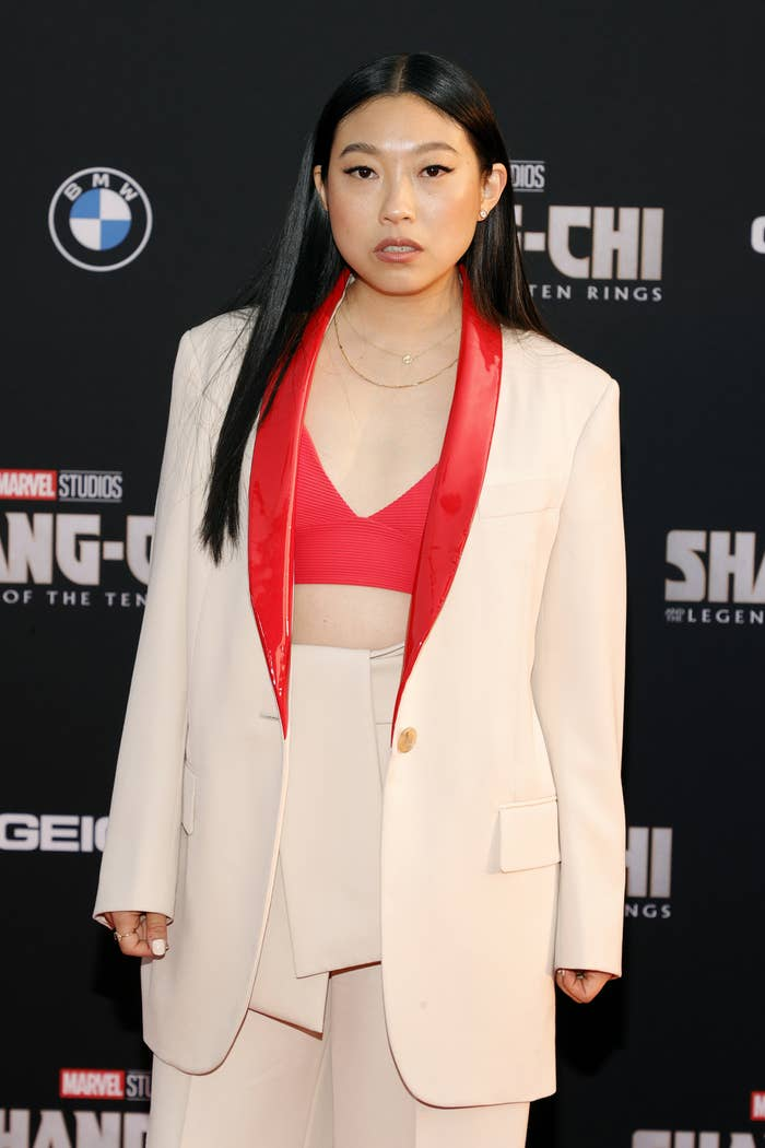 Awkwafina wearing a suit and matching crop top at the Shang-Chi and the Legend of the Ten Rings premiere