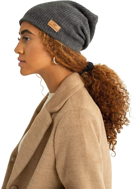 a model wearing the gray grace eleyae satin lined wool beanie