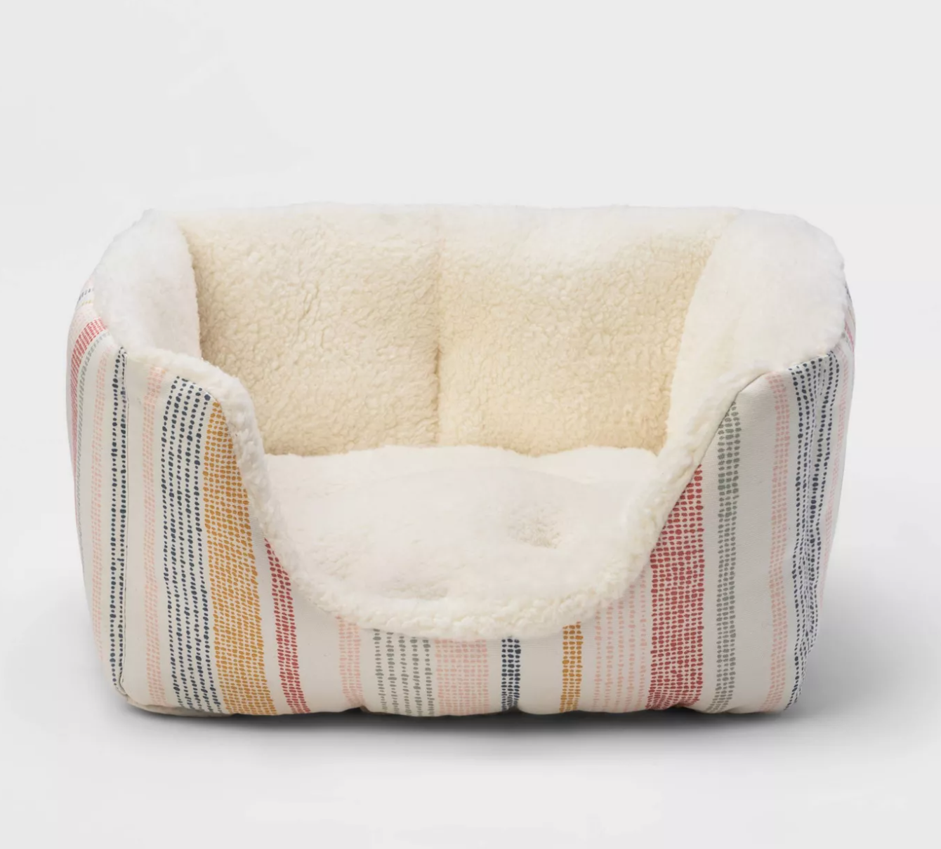 a high walled pet bed with a plush inside and striped design on the outside