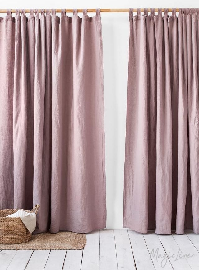 a set of dusty rose colored curtains