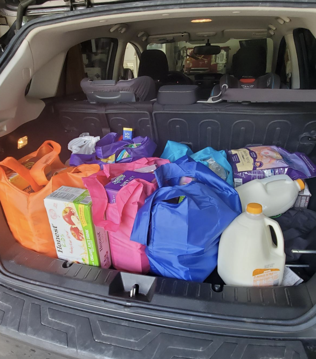 Reviewer image of colorful bags full of groceries in a car trunk