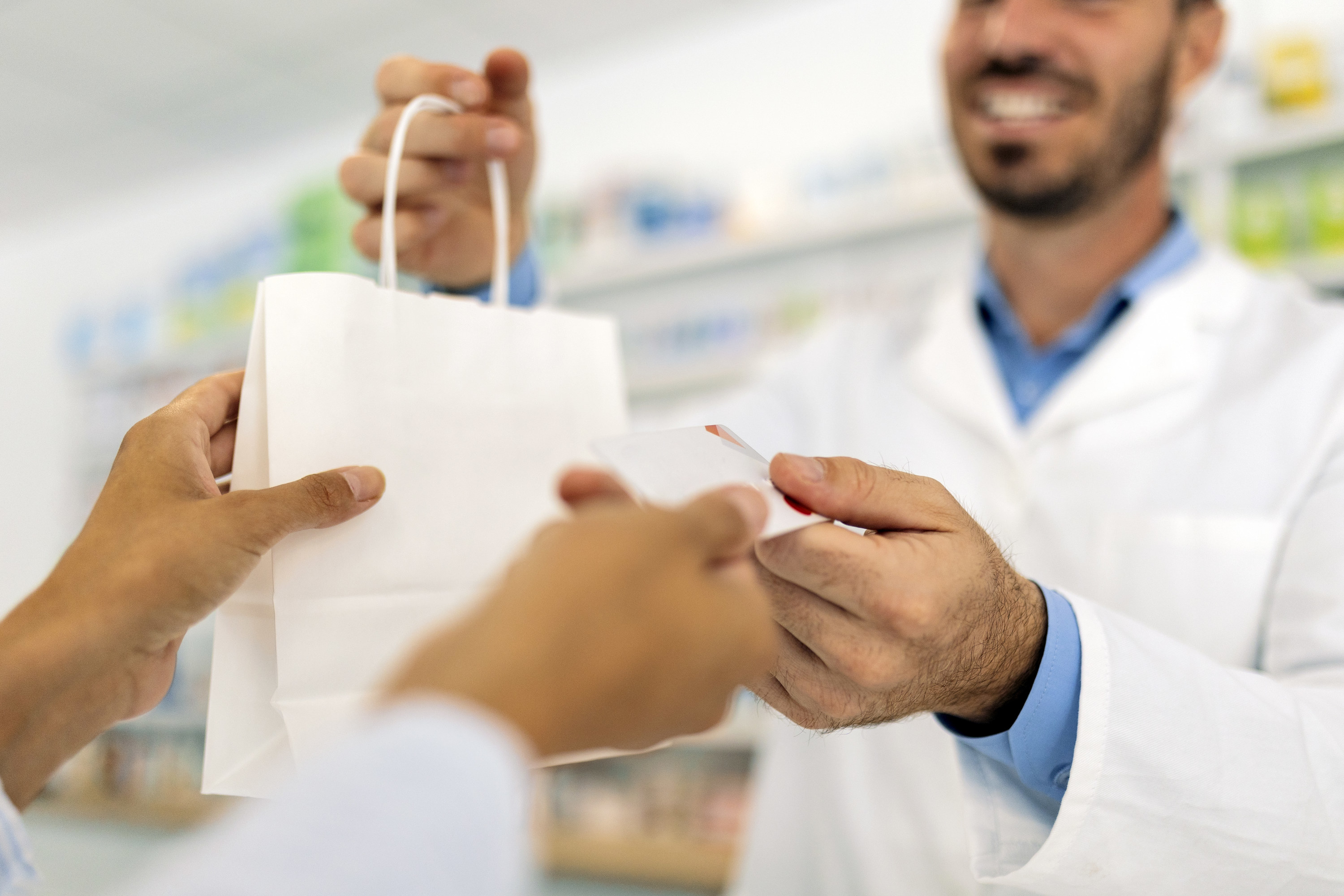 A person paying for their pharmacy prescription