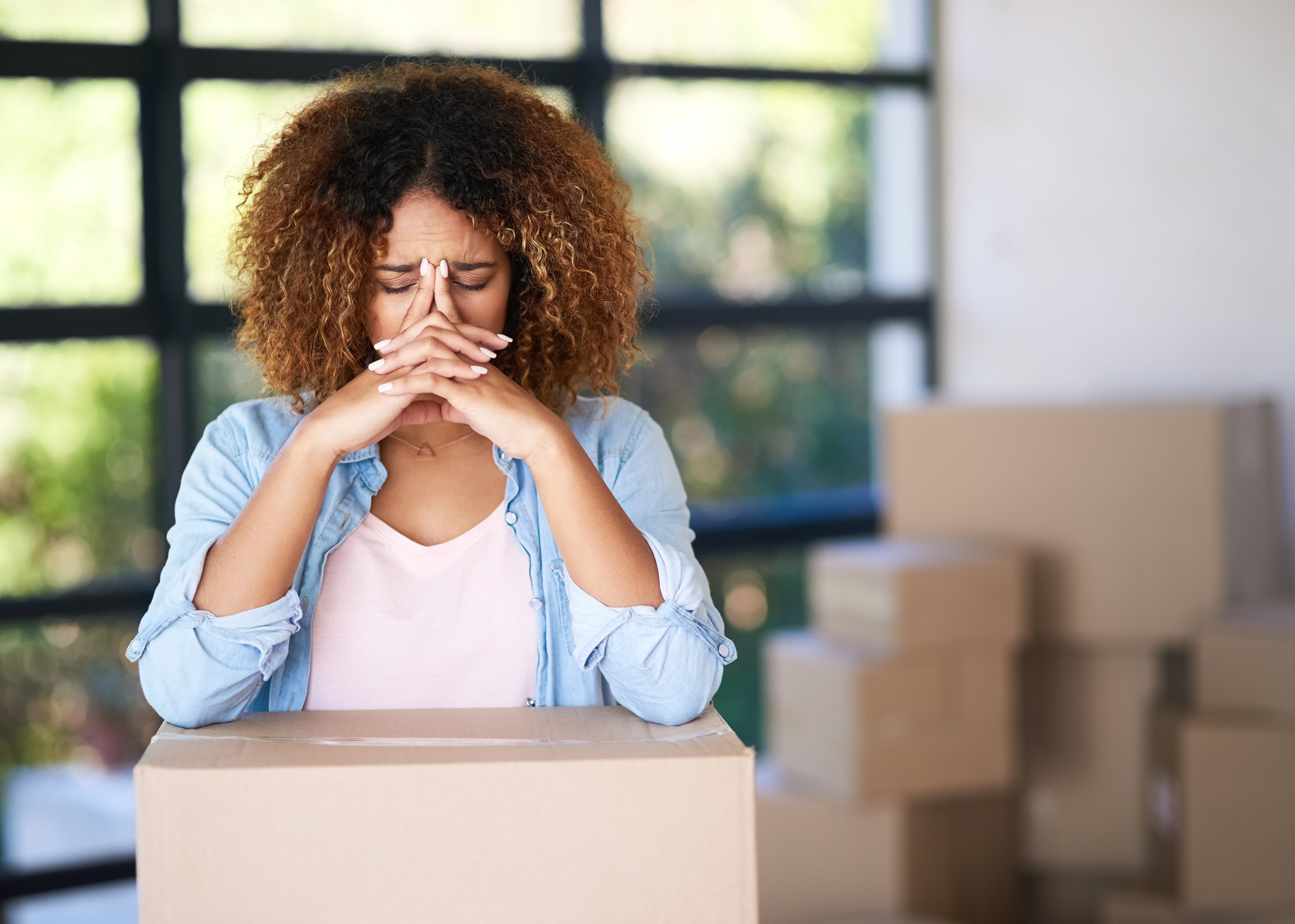 A woman appearing stressed while moving