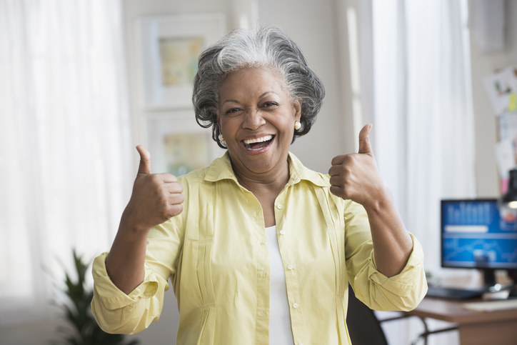 woman with her thumbs up