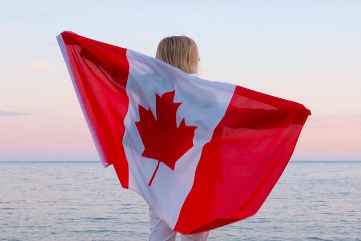 Woman with Canadian flag on beach