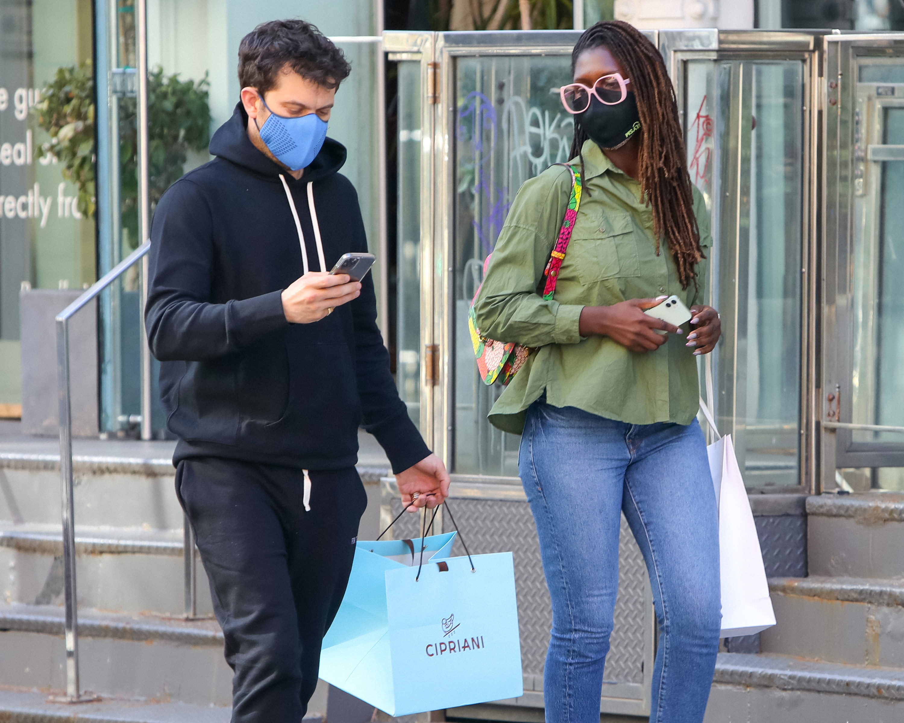 Jackson and Turner-Smith walk down the street while wearing masks