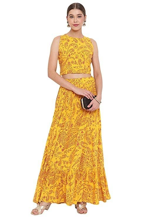 A bright yellow top and skirt set with a maroon pattern on it