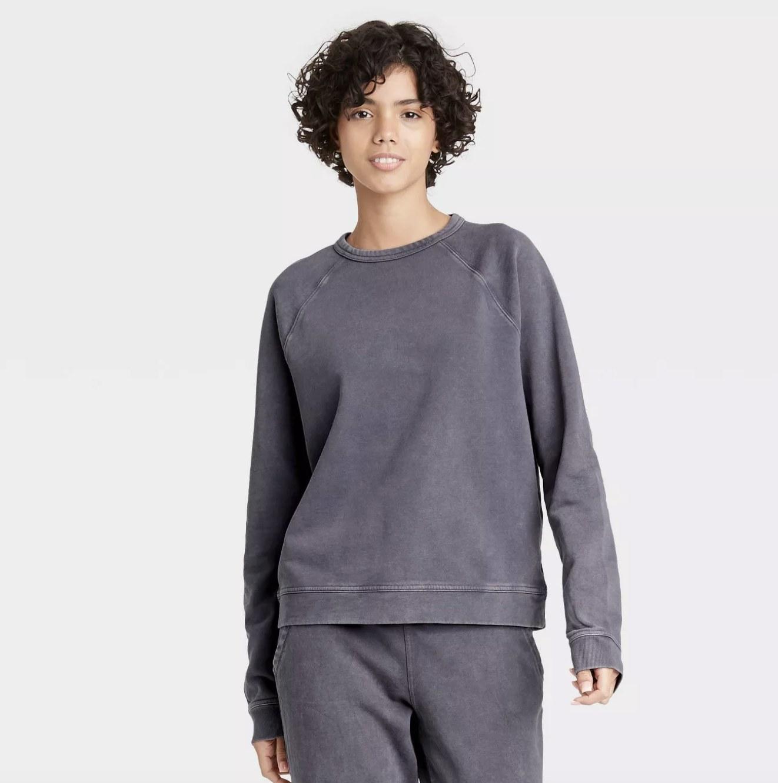 the sweatshirt on a model in dark gray