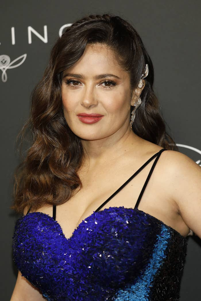 Salma Hayek poses for a picture on the red carpet while wearing a dress