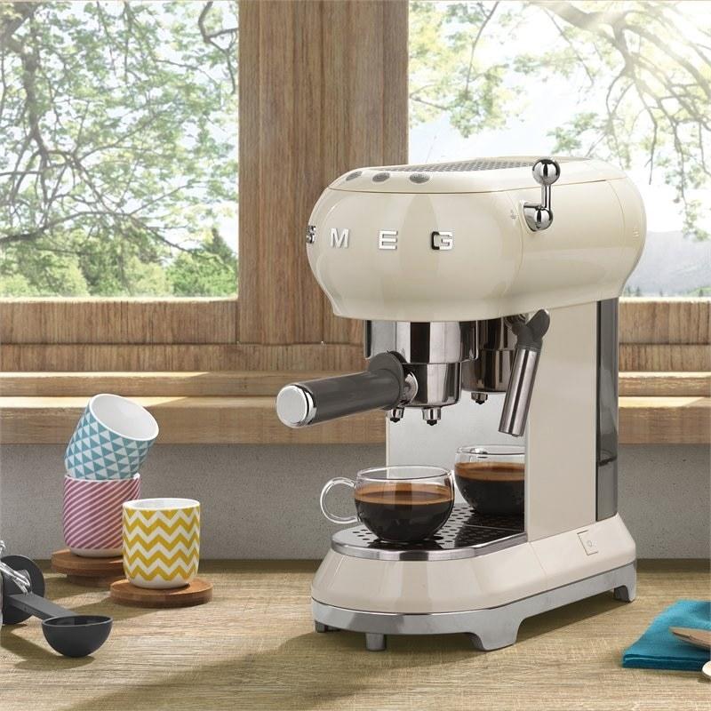 the espresso machine on a counter next to mugs