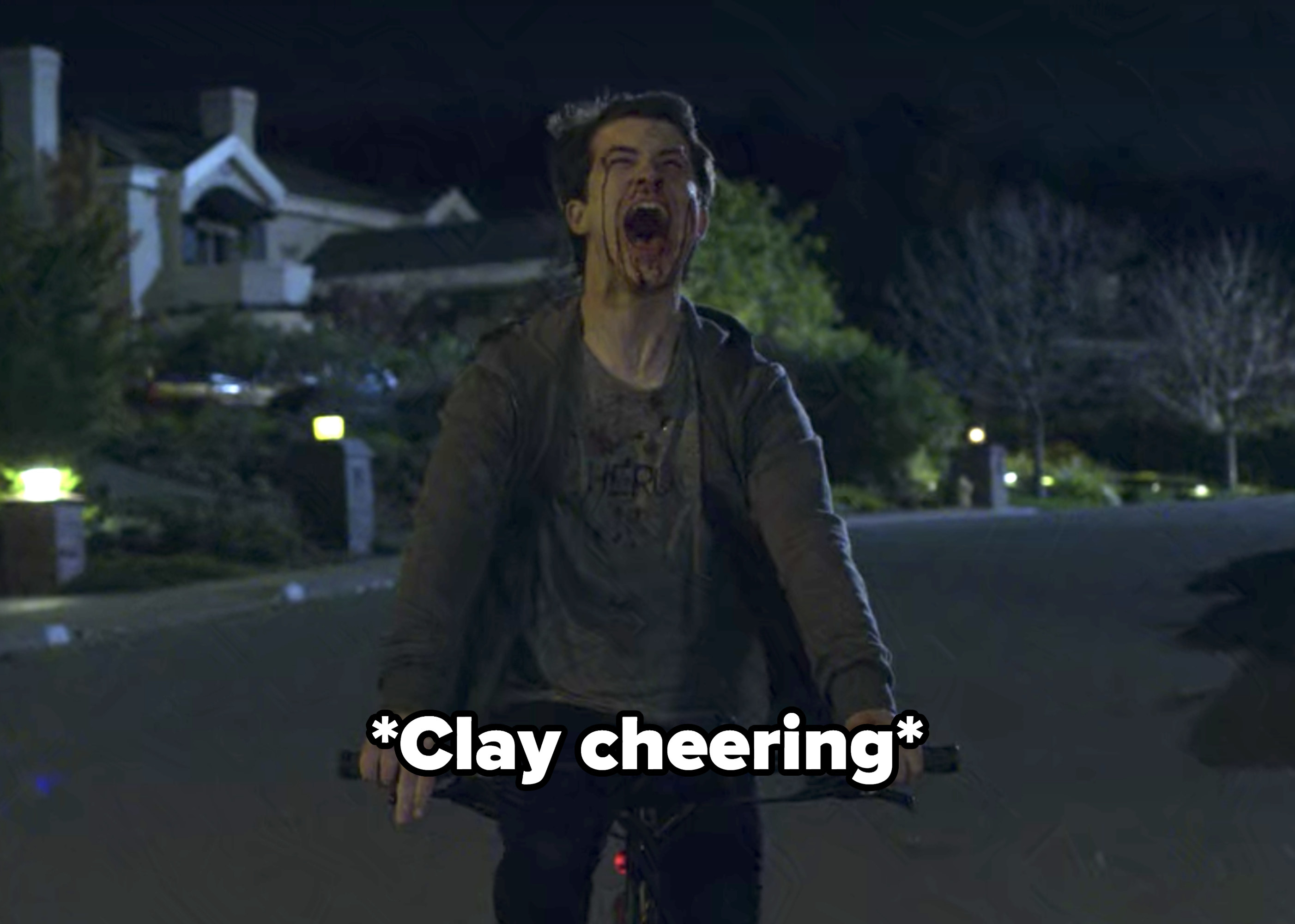 Clay cheering as he rides his bike