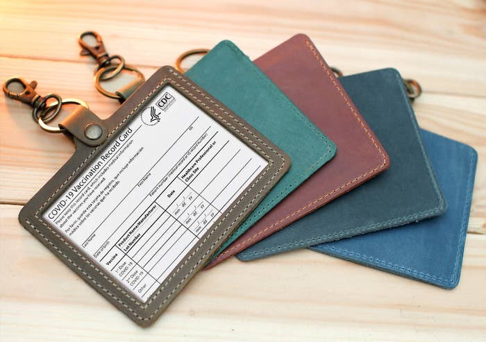 the vaccine card holder in various colors