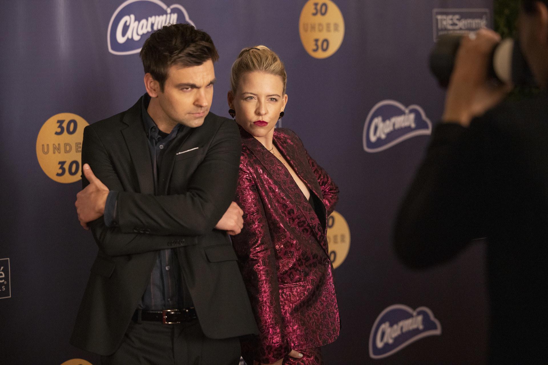 Drew Tarver and Helene York pose on a red carpet