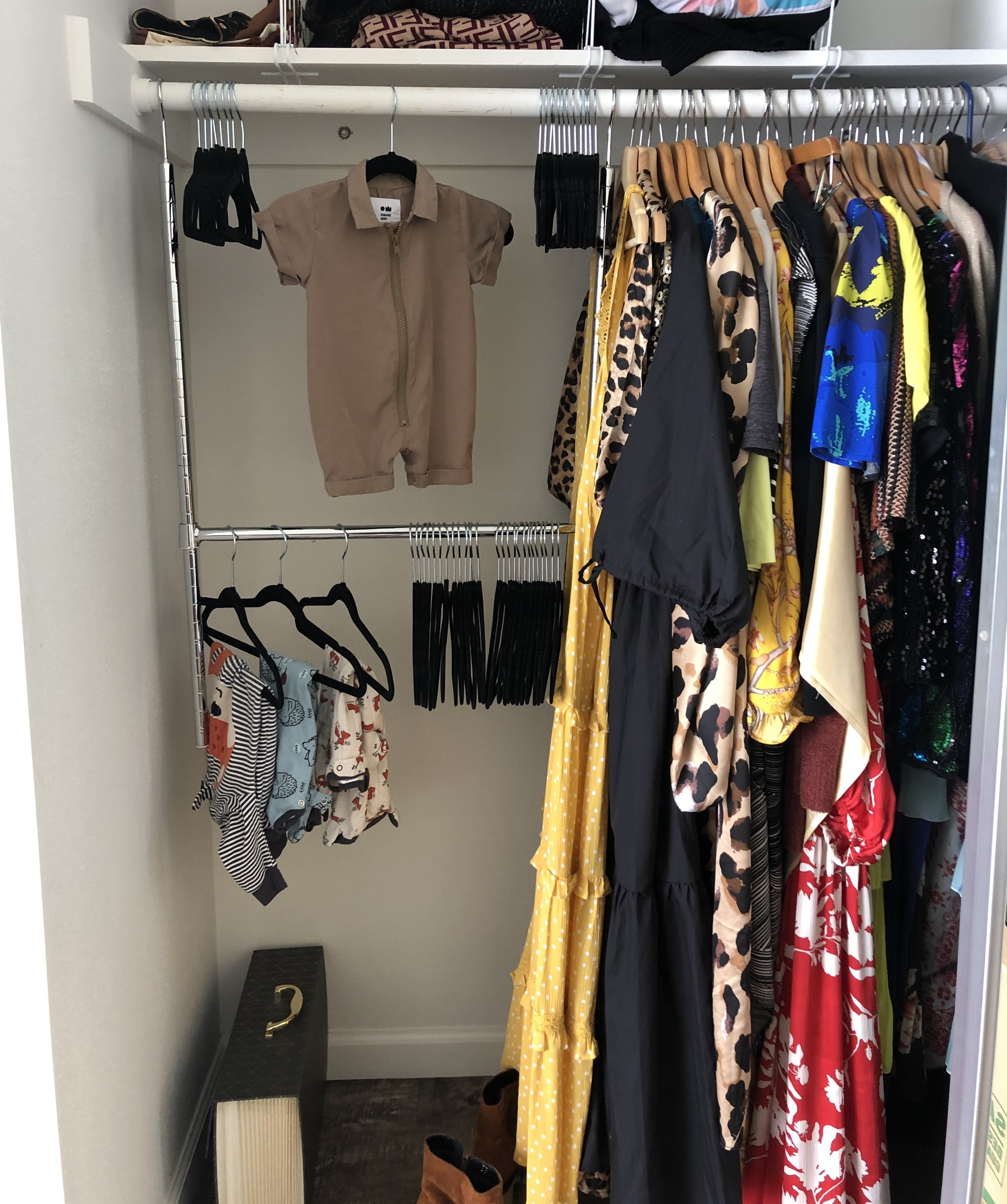 A closet is shown with the double hanging rod