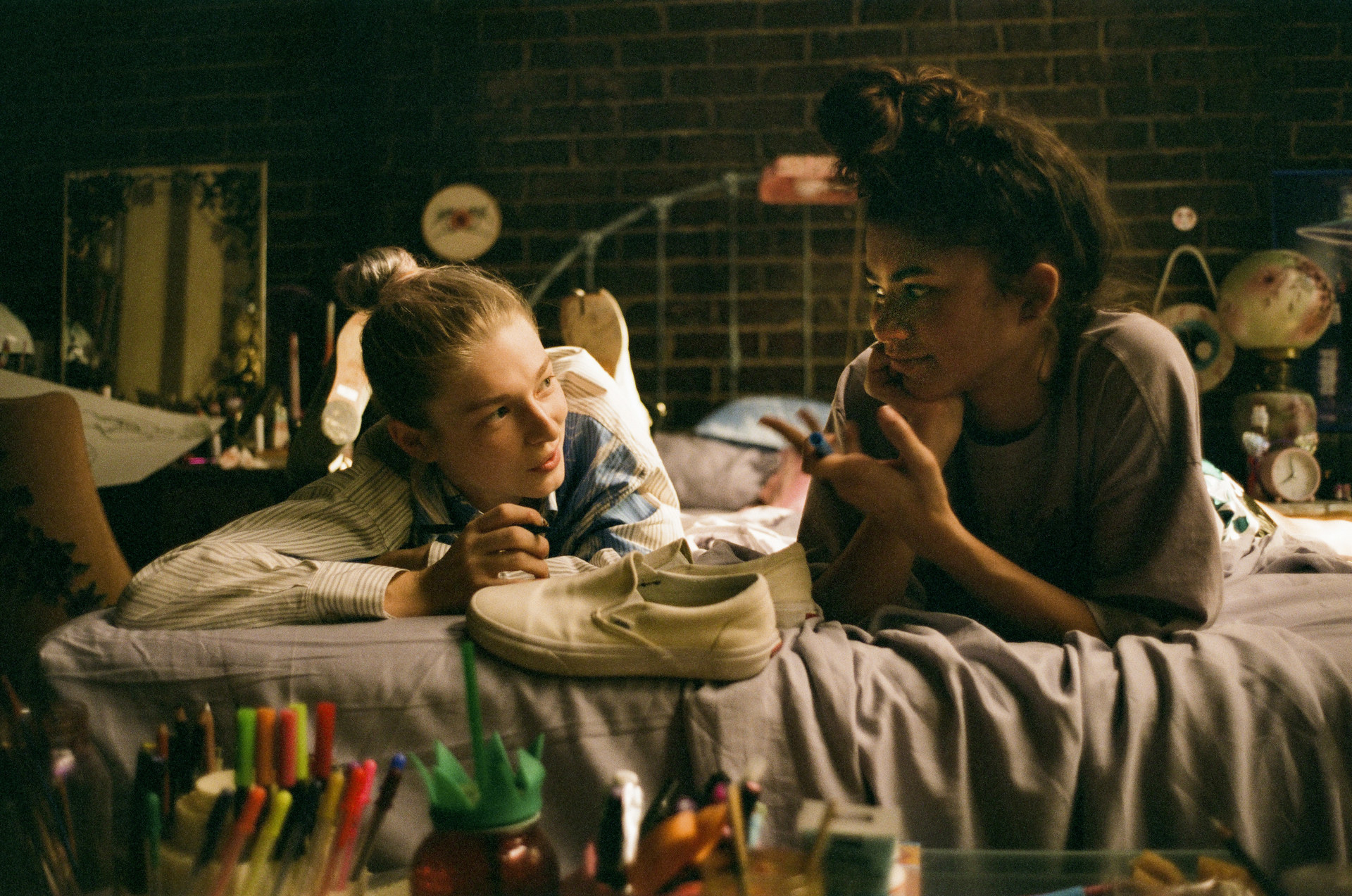 Hunter Schafer and Zendaya lay on a bed