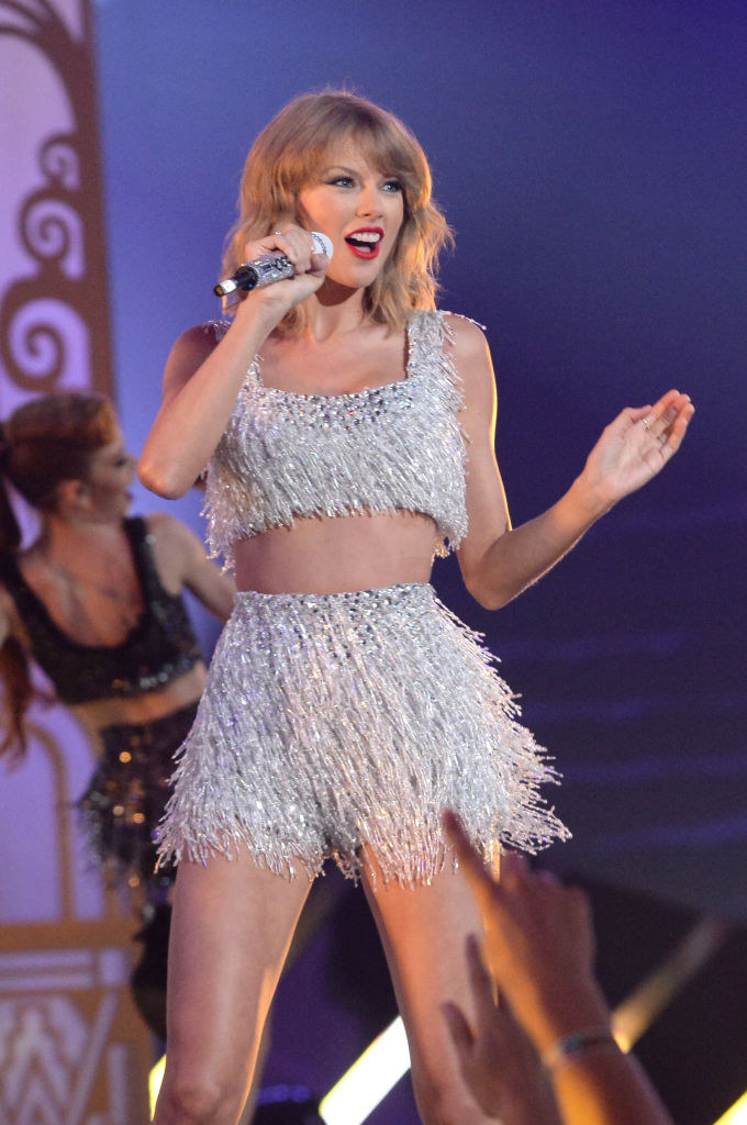 Taylor Swift in a sparkly two piece set performing at the 2014 VMAs