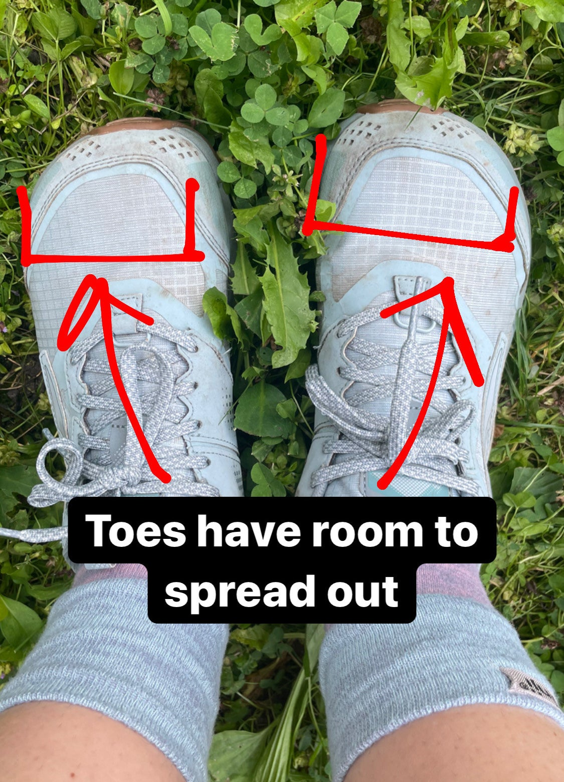 writer in the tow socks and altra trail runners captioned toes have room to spread out with arrows illustrating where her toes are in the shoe's wide toe box