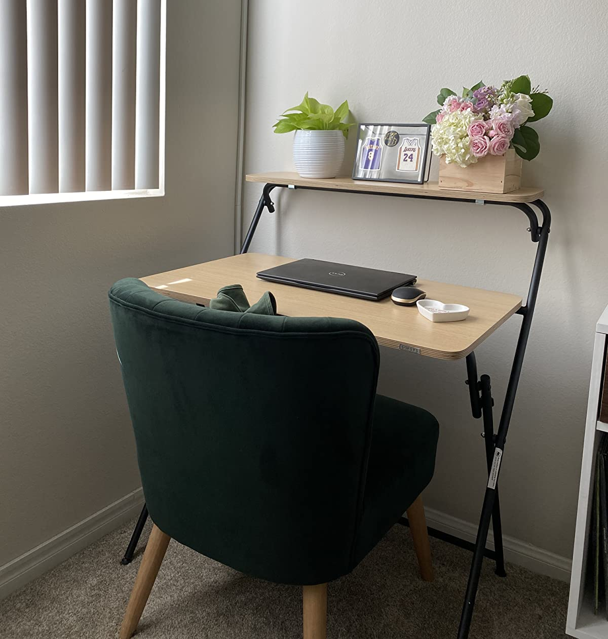 light wood two-tier desk in corner of reviewer's home