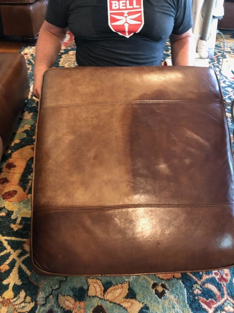 reviewer image of a leather couch with a section dulled and scratched and another section polished and unscratched