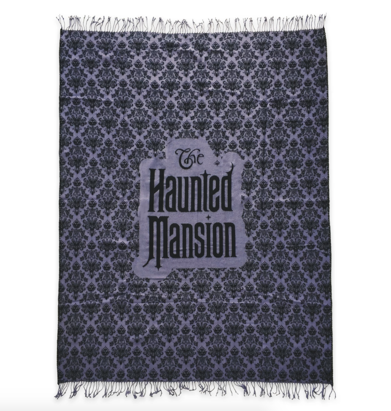a purple throw blanket in the haunted mansion wallpaper with the logo in the middle