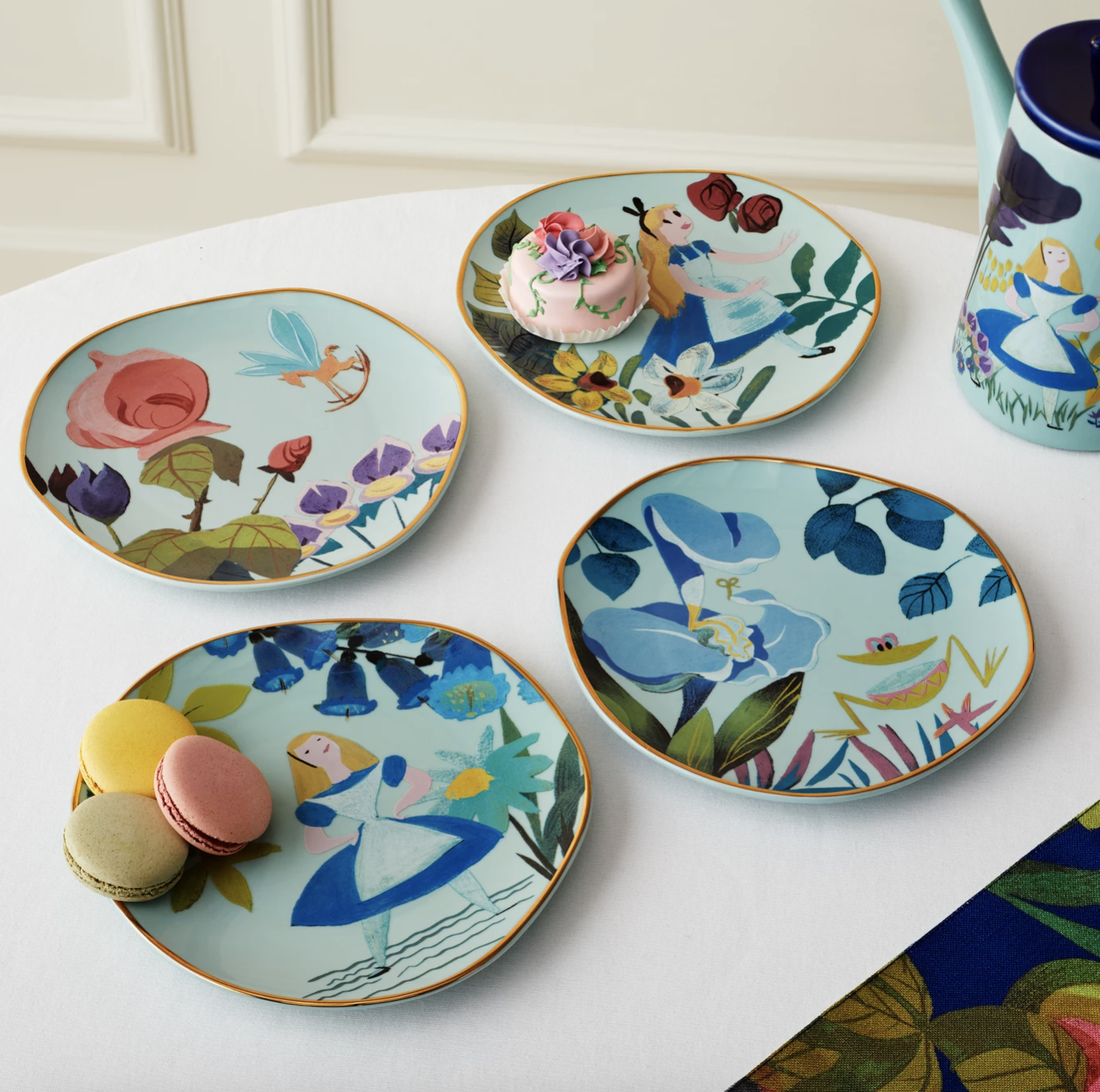 beautiful floral plates with scenes from alice in wonderland on them
