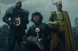 Boastful Loki and Older Loki stand behind Kid Loki who cradles Alligator Loki in his lap