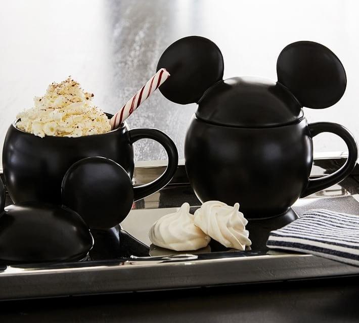 a black mug with a mickey ear lid on it