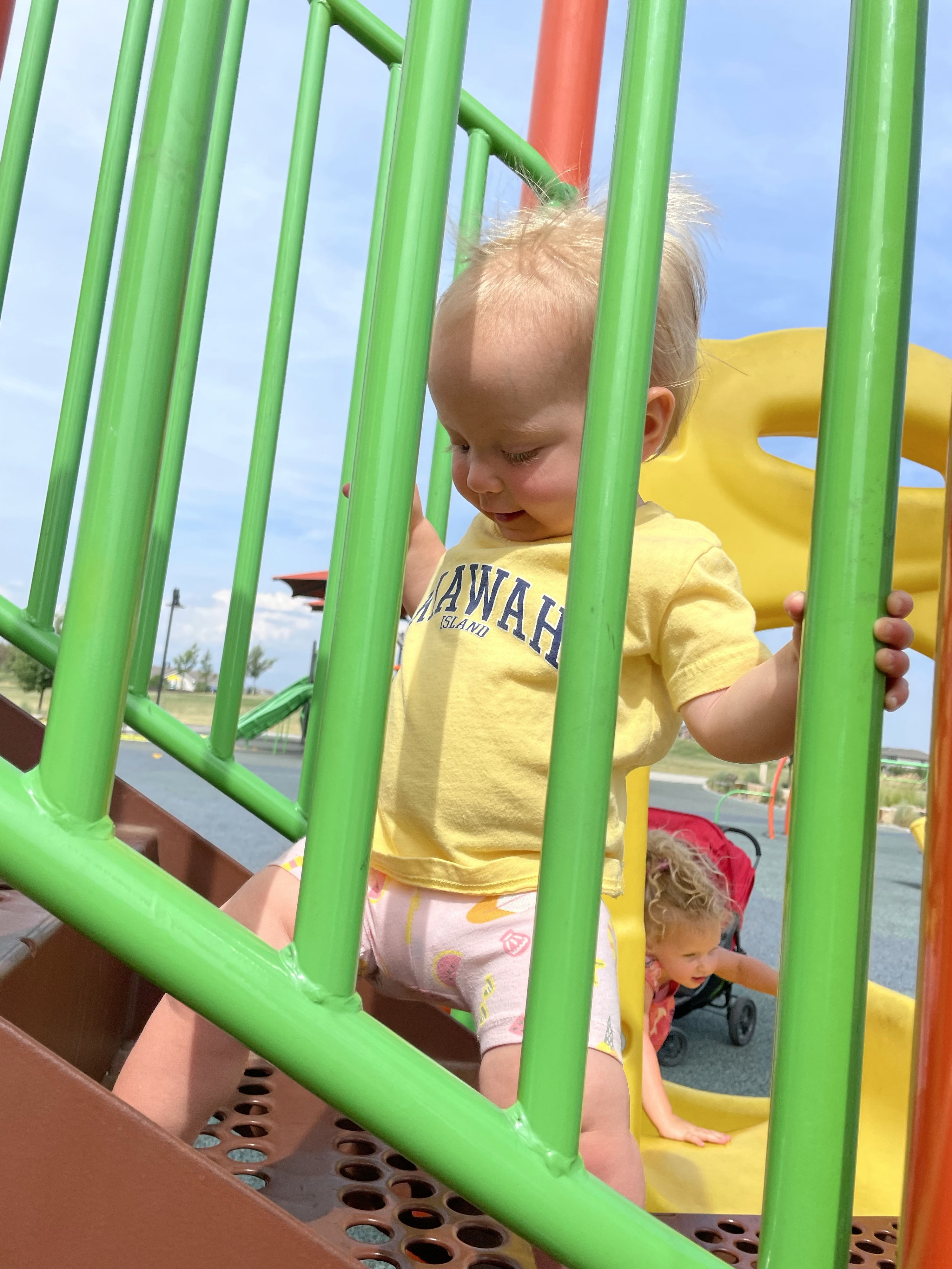 The author's daughter playing at the park