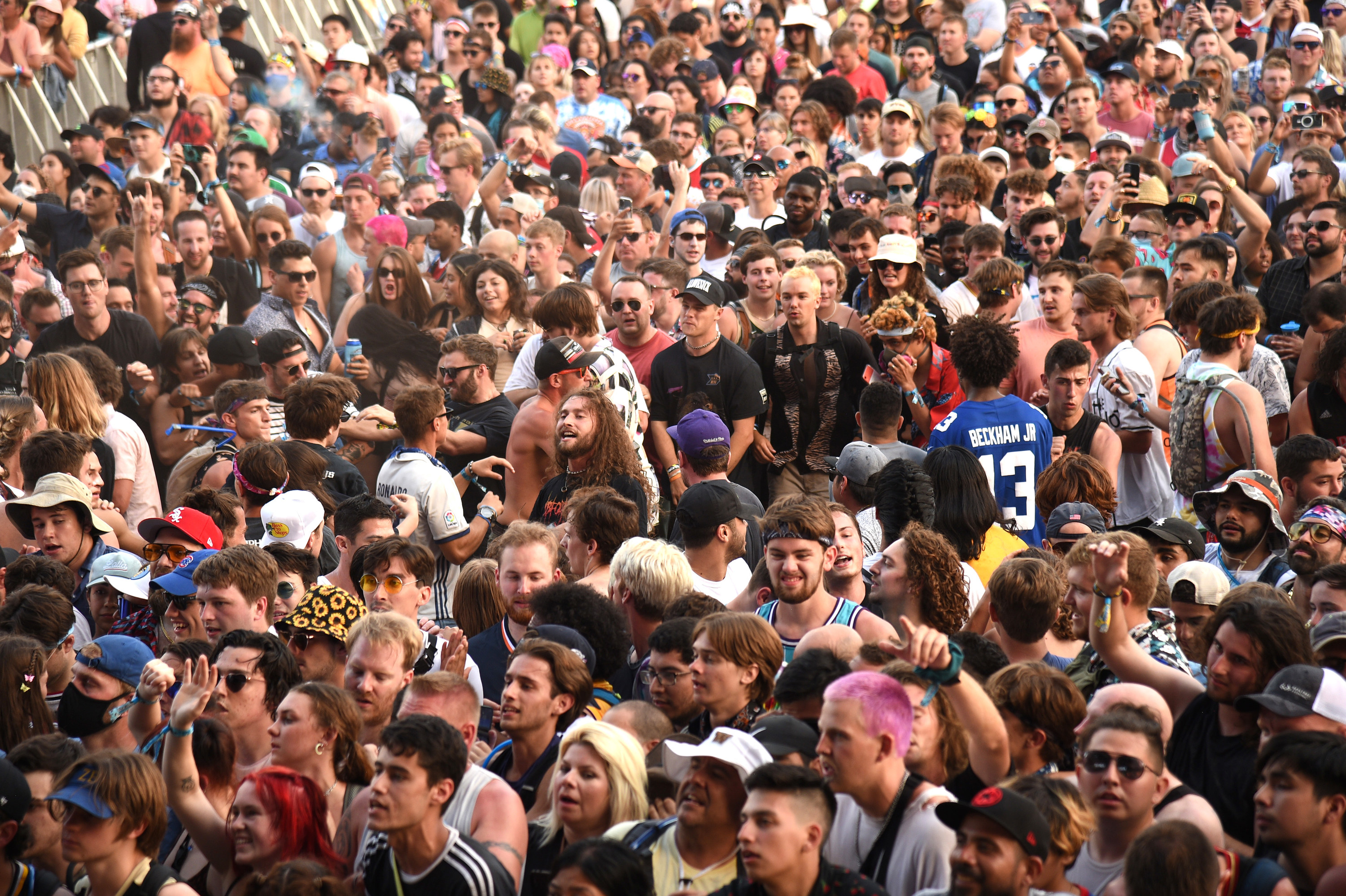 A candid view of a crowd of people at Lollapalooza music festival in Chicago.