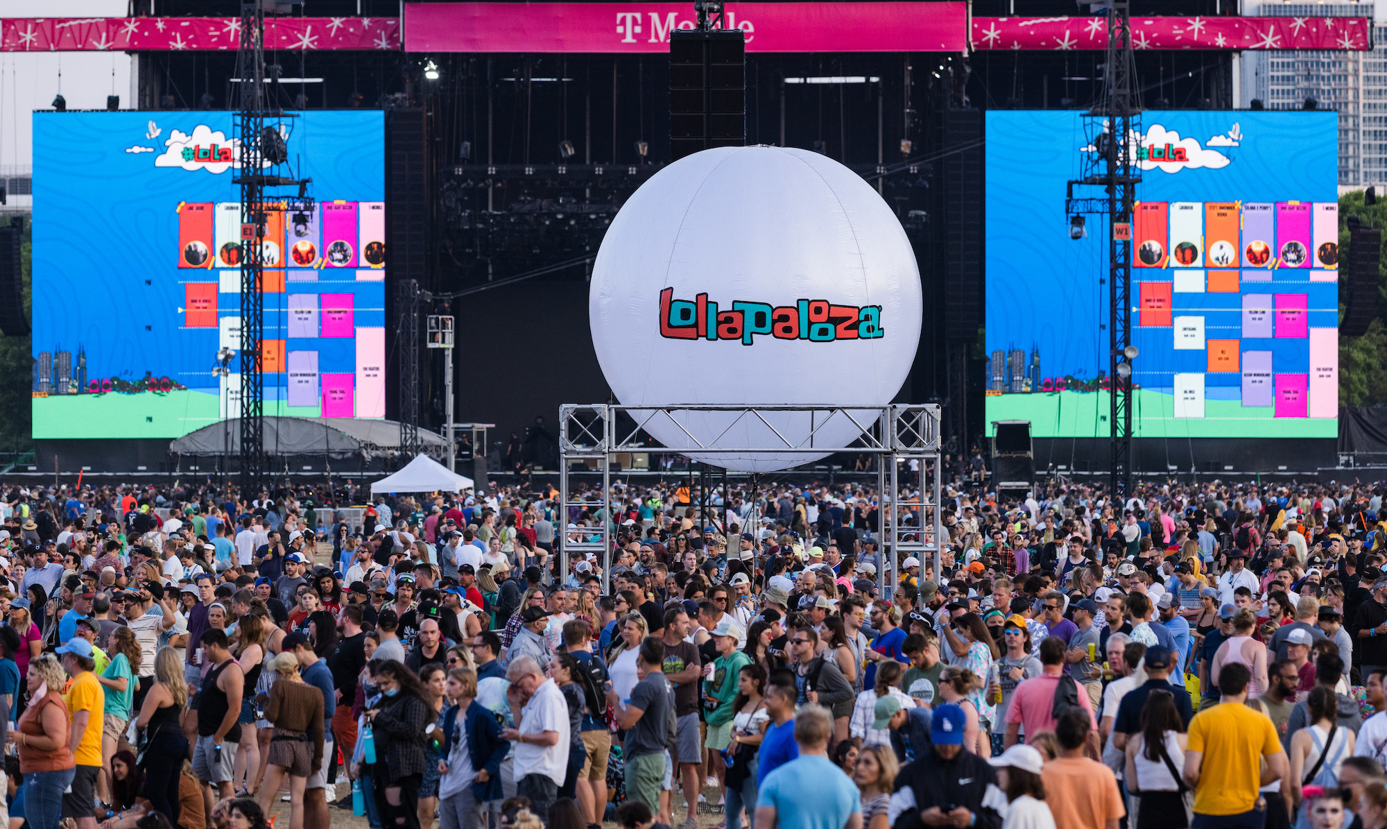 Thousands of young people pack into a festival venue for Lollapalooza in Chicago.