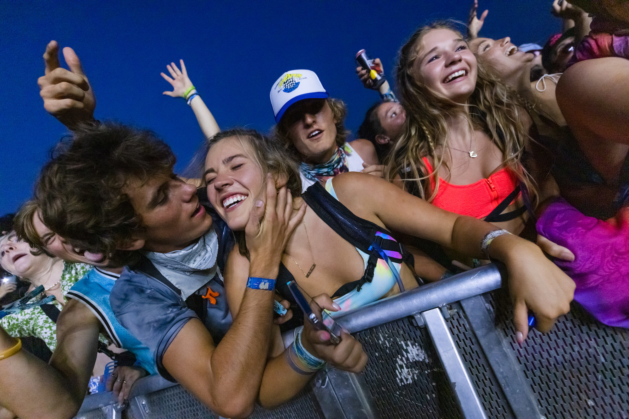 A male attendee motions to kiss a female attendee at Lollapalooza music festival.