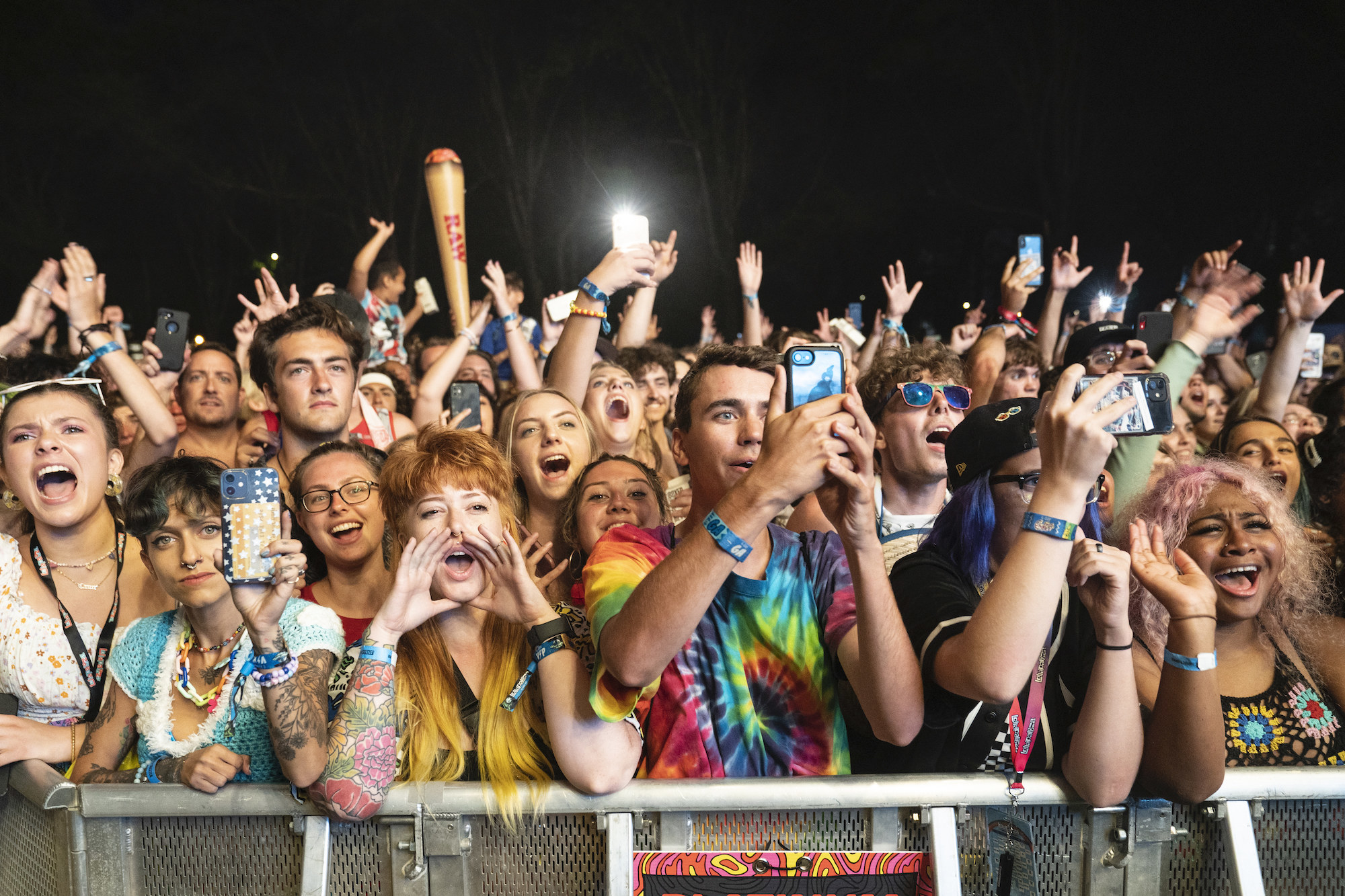 Fans pack behind barricades for the evening music set at Lollapalooza music festival.