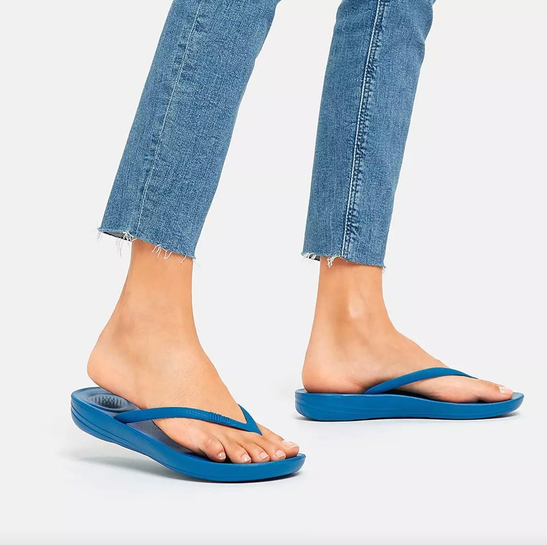the pair of ergonomic flip-flops in ocean blue