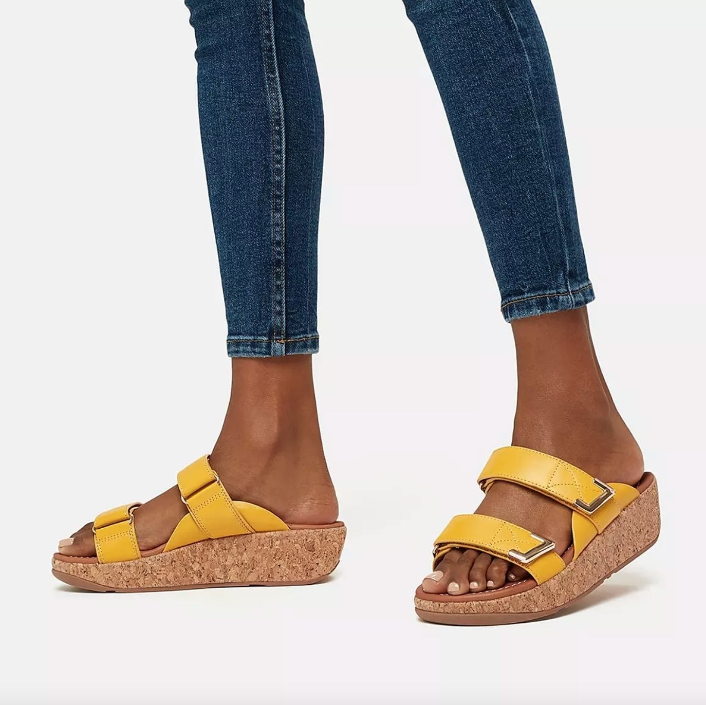 the pair of adjustable leather slides in sunshine yellow