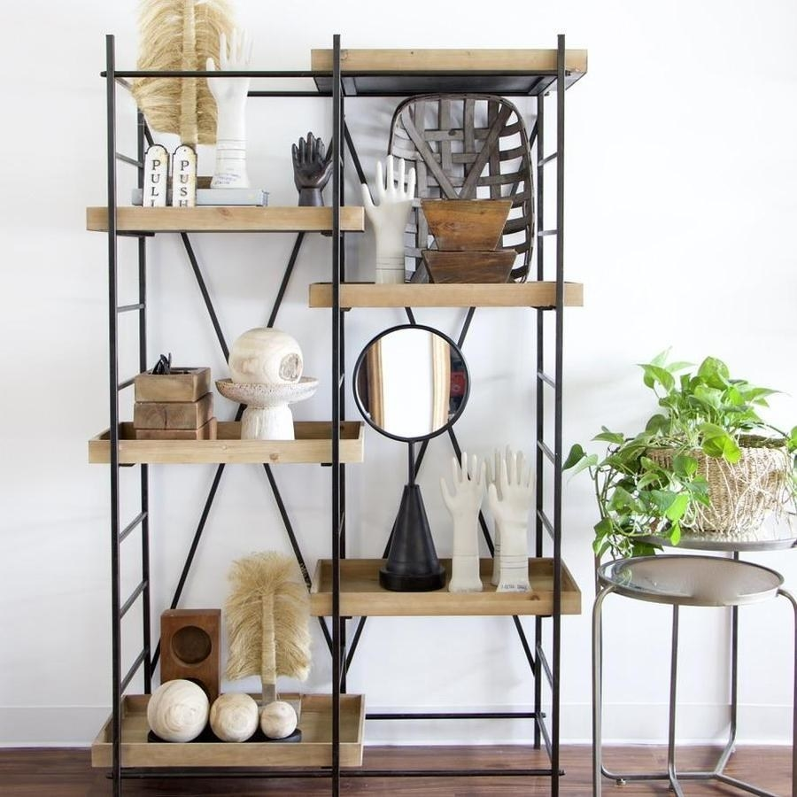 The shelving unit with six wooden shelves at different heights with knick knacks on them