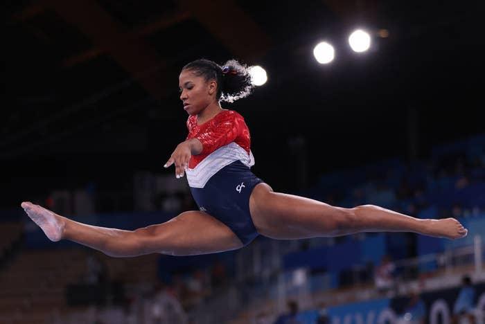 Jordan Chiles doing a jump split in the air