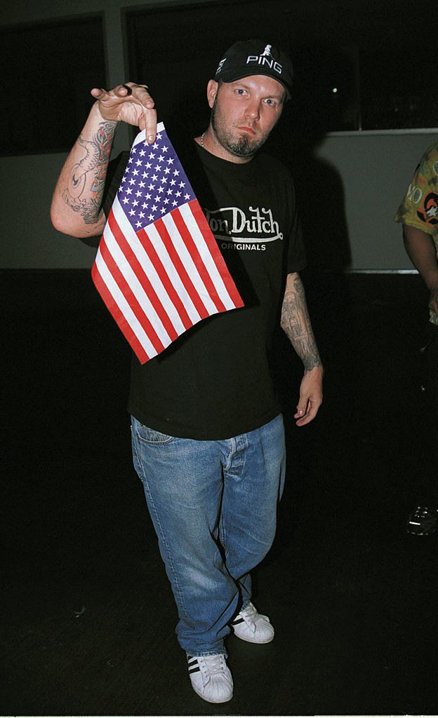 Fred holding a small U.S. flag