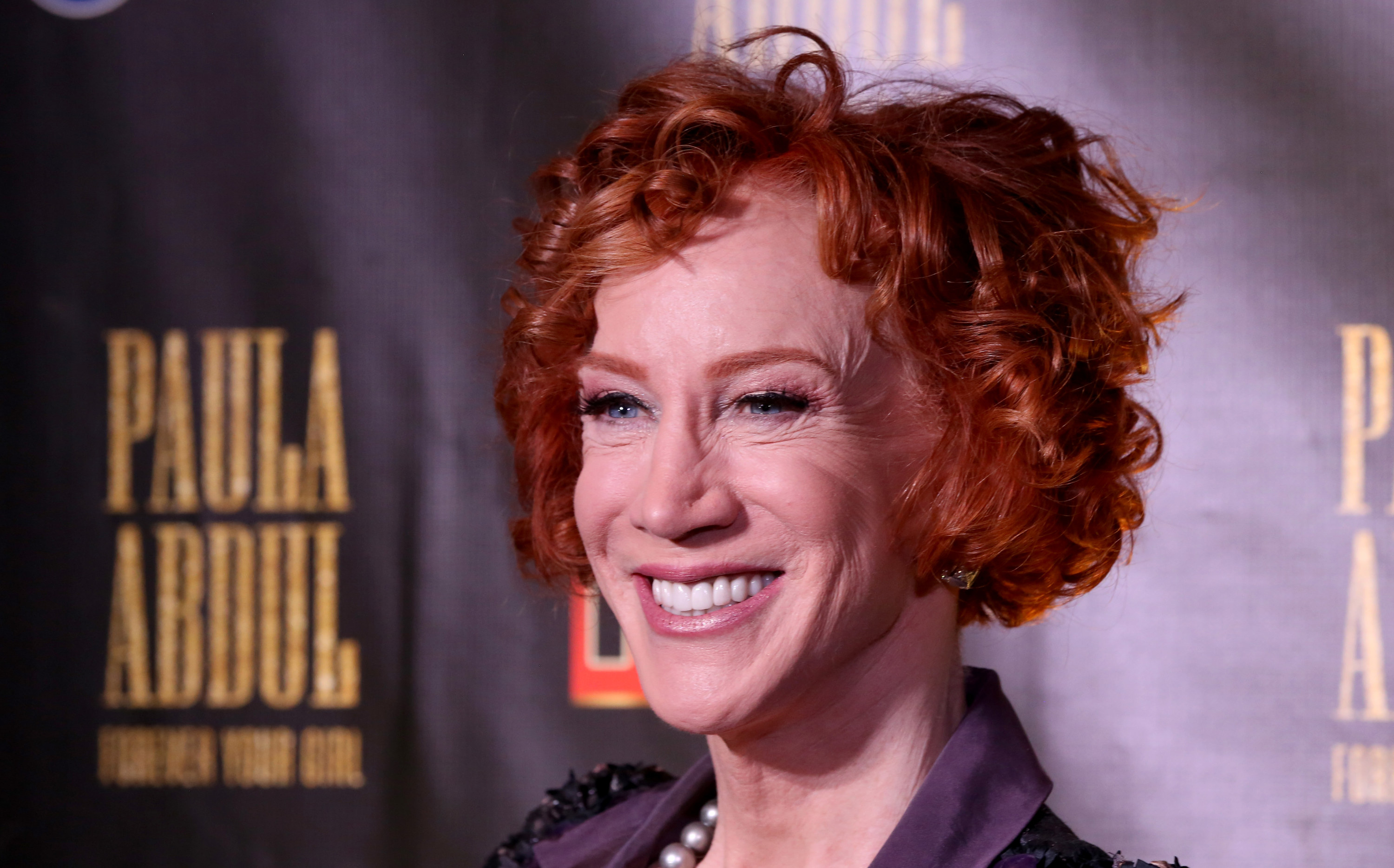 Closeup photo of Kathy Griffin smiling at something off-camera