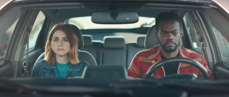Aya Cash and William Jackson Harper look sad in a car