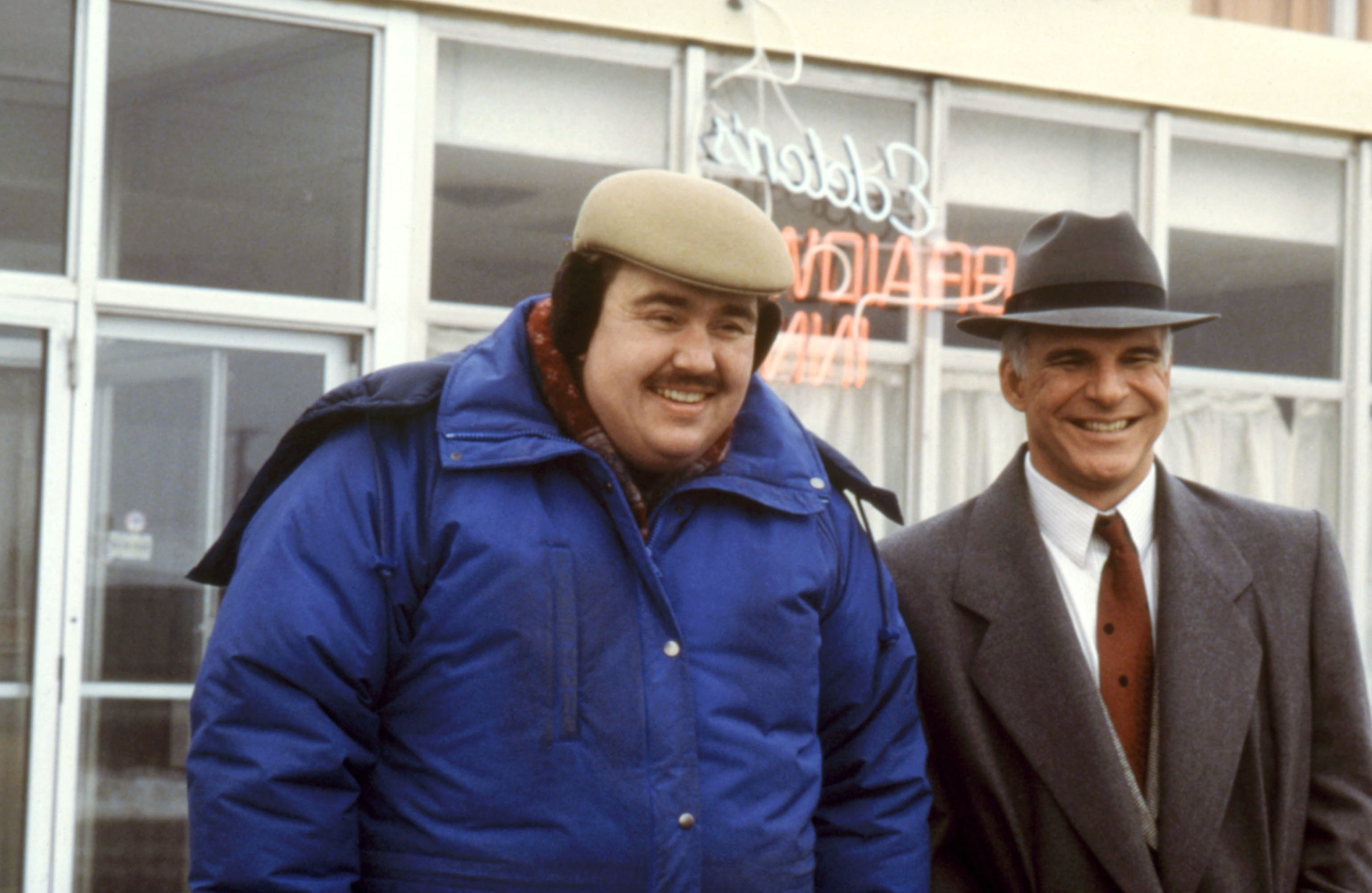 John Candy and Steve Martin smiling