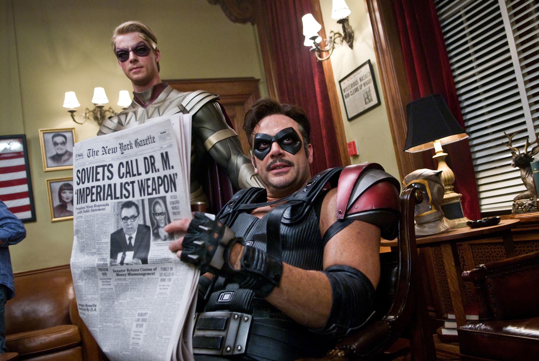 Matthew Goode looks annoyed while Jeffrey Dean Morgan reads a newspaper