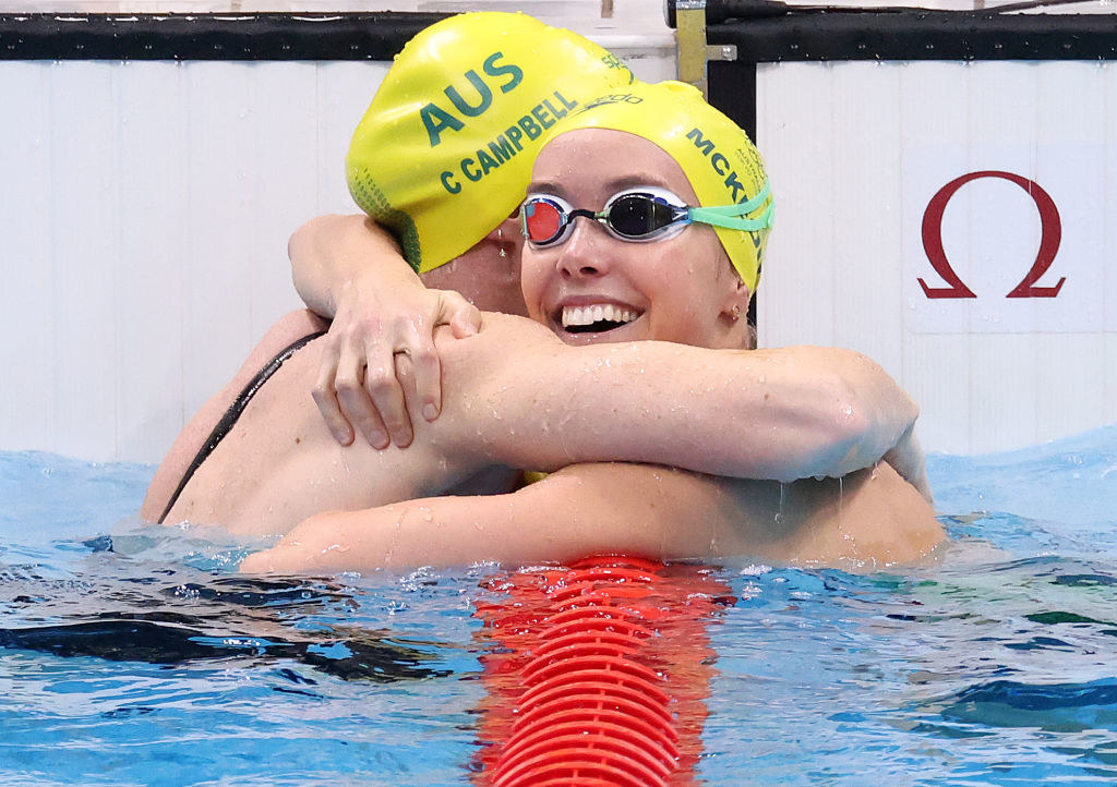 Cate Campbell and Emma McKeon of Team Australia hugging after a swimming event at the Tokyo Olympics