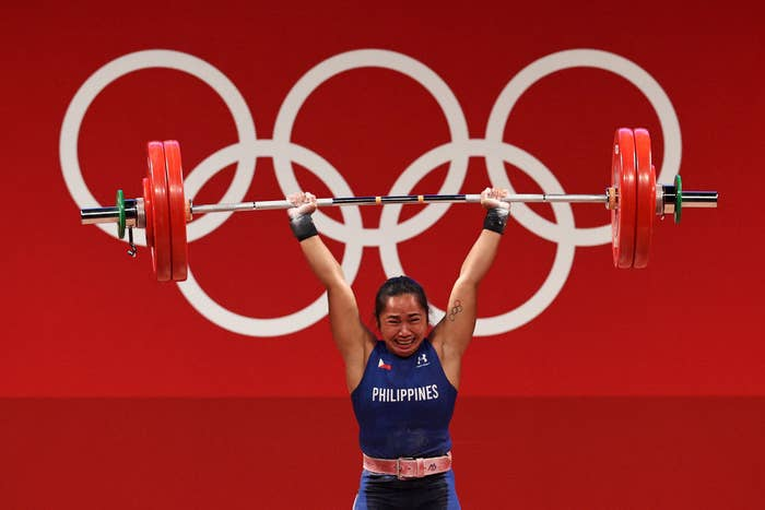 Hidilyn Diaz of Team Philippines competes during the Weightlifting - Women's 55kg Group