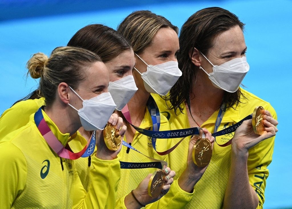 Gold medallists (from L-R) Australia's Bronte Campbell, Australia's Meg Harris, Australia's Emma Mckeon and Australia's Cate Campbell pose after the final of the women's 4x100m freestyle relay swimming event