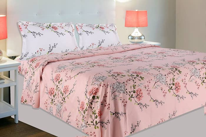 A pink and white bedsheet on a bed